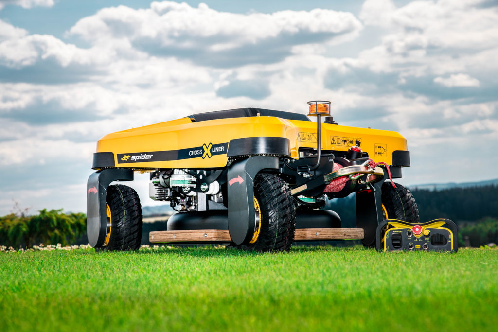 Spider Cross Liner Remote Control Mower Positioned on Grass on a Sunny Day