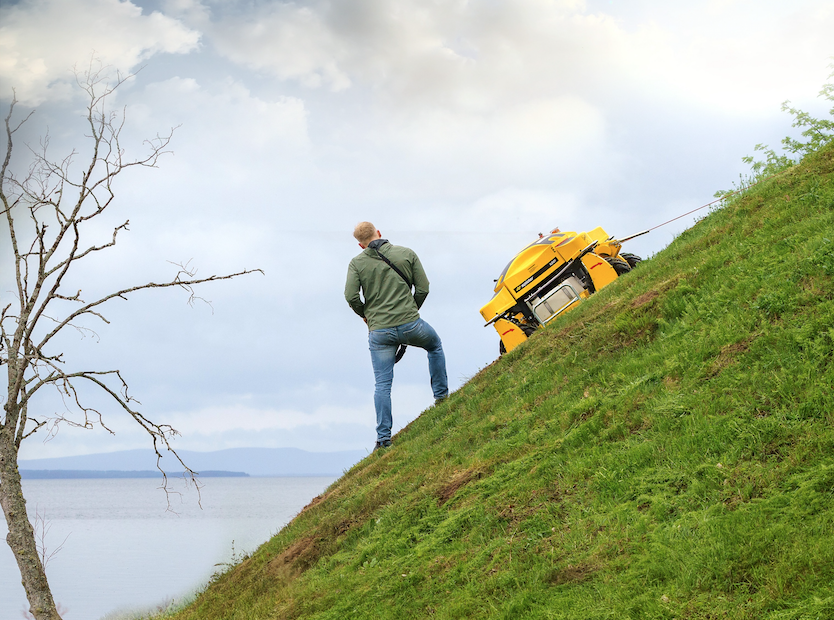 The Spider ILD01 Remote Control Slope Mower Mowing Grass on a 40-Degree Slope