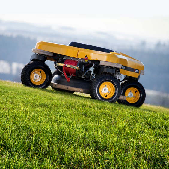 remote-control SPIDER commercial mower cutting grass on a hill