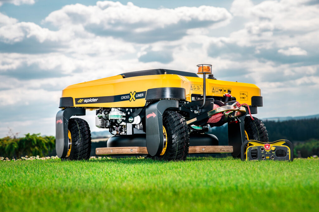 SPIDER CROSS LINER Remote-Control Slope Mower Positioned on Flat Grass
