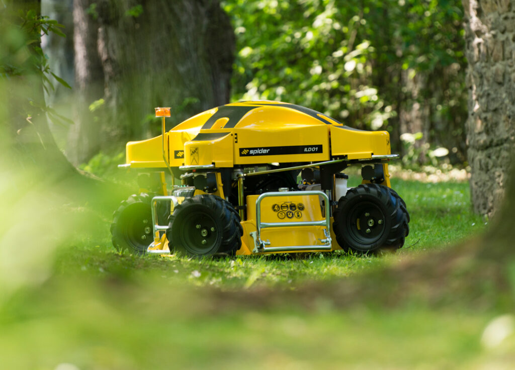 SPIDER ILD01 Mower Positioned on Grass in a Wooded Area