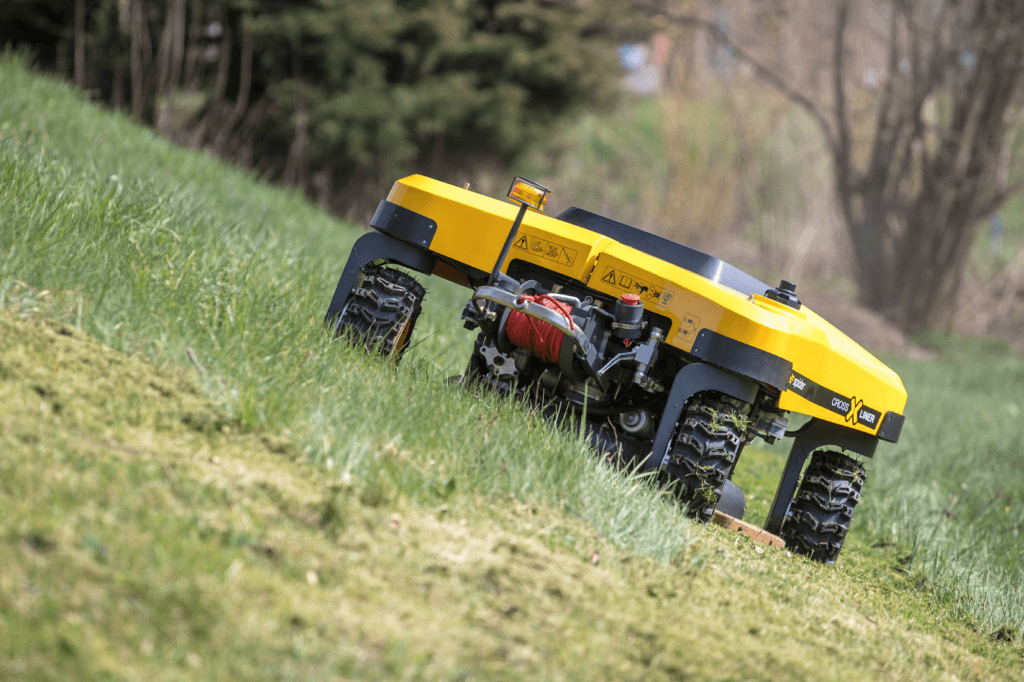 SPIDER mower cutting grass on an angle