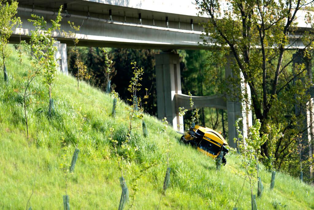 SPIDER ILD02 hillside mower working on a steep embankment