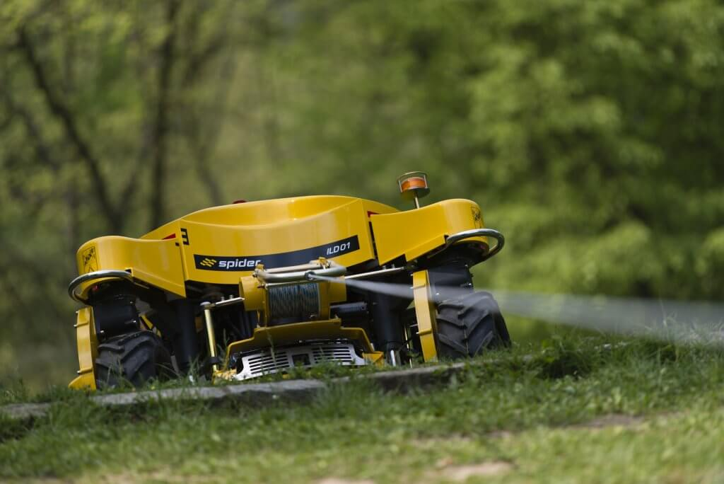 A teathered Spider Mower mowing a slope